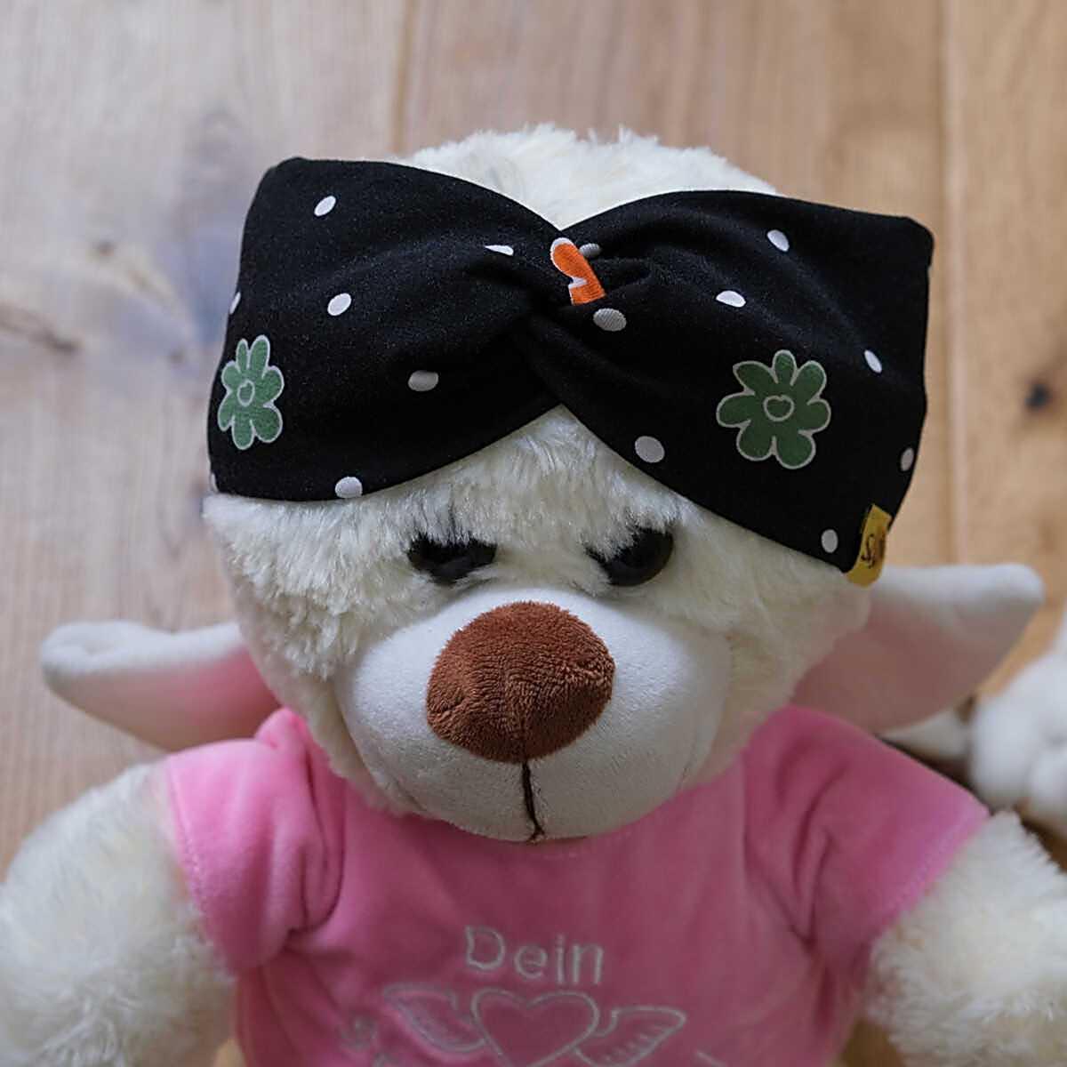 """Bär-Model mit stylischem Knoten-Stirnband aus Jersey mit Muster """"schwarz mit Blumen"""""""